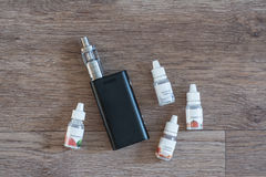 Electronic cigarette with liquids close up Stock Photography