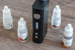 Electronic cigarette with liquids close up Stock Photo