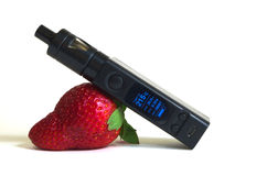 Electronic cigarette. Lying on a strawberry Royalty Free Stock Photos