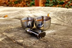 Electronic cigarette mod, advanced e-cigarette in nature ambient. royalty free stock photo