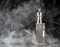 Electronic cigarette over a dark background Stock Photos