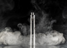 Electronic cigarette over a dark background Royalty Free Stock Photography