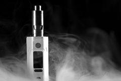 Electronic cigarette over a dark background. E-cigarette for vaping. Popular devices Stock Photography