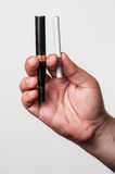 Electronic cigarette and a real cigarette Royalty Free Stock Photos