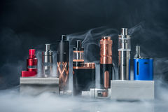 Electronic Cigarette. And smoke on black background royalty free stock photo