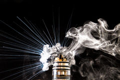 Electronic Cigarette smoke explosion. Vaporizer smoke explosion on isolated black background in studio Royalty Free Stock Images