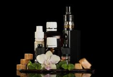 Electronic cigarette for smoking, set of liquids and aromatic oils, sweets Royalty Free Stock Photo