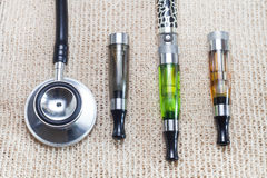 Electronic cigarette and stethoscope Stock Photo