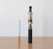 Electronic cigarette with tobacco cigarette Stock Photo