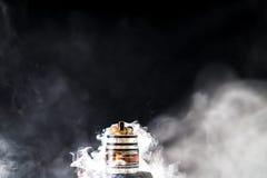 Electronic Cigarette vape explosion. Vaporizer smoke explosion on isolated black background in studio stock photo
