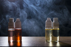 Electronic cigarette, vaping device with e liquid background. Isolated vape e liquid for electronic cigarette on a dark background stock photo