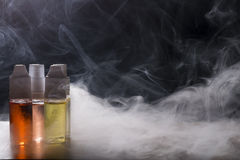 Electronic cigarette, vaping device with e liquid background. Isolated vape e liquid for electronic cigarette shops royalty free stock photography