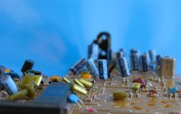 Electronic Circuit Board. On Blue royalty free stock images