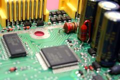 Electronic Circuit Board. Printed circuit board with various electronics components assembled on it Stock Photo