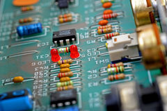Electronic circuit board. Old electronic circuit board with transistors and other electronic components Stock Image