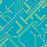 Electronic circuit board. Unpopulated electronic circuit board with  green conductive tracks drilled for soldering connections to components on a blue insulating Stock Photo