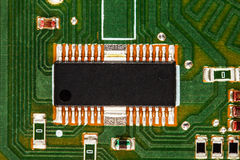 Electronic circuit board with chip and radio components Royalty Free Stock Photo