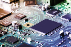 Electronic circuit board close up. Stock Photos