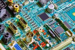 Electronic circuit board close up. Stock Photos