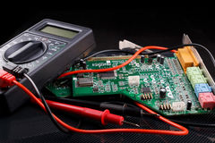 Electronic circuit board and digital multimeter Stock Photo