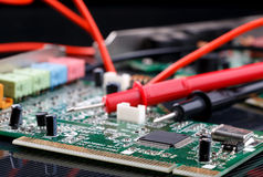 Electronic circuit board and digital multimeter Royalty Free Stock Image