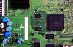 Electronic circuit board green color close-up. High-tech computer motherboard for tv stock photography