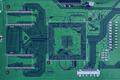 Electronic circuit board green color close-up. High-tech computer motherboard for tv royalty free stock image