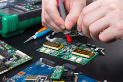 Electronic circuit board inspecting close up Royalty Free Stock Images