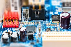 Electronic circuit board PCB. Creative abstract electronic industry business technology concept: macro view of computer PC motherboard or mainboard circuit board royalty free stock images
