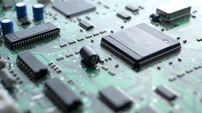 Electronic circuit board with processor, chips and capacitors stock footage