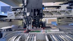 Automated Circut Board machine Produces Printed digital electronic board. 4K. stock footage