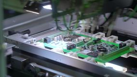 Electronic circuit board production. Automated Circut Board machine Produces Printed digital electronic board stock footage