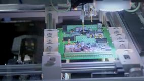 Electronic circuit board production. Automated Circut Board machine Produces Printed digital electronic board. Electronics contract manufacturing. Manufacture stock footage