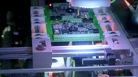 Electronic circuit board production. Automated Circut Board machine Produces Printed digital electronic board stock video footage