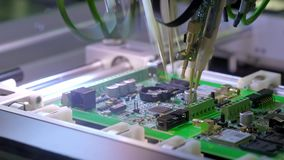 Electronic circuit board production. Automated circuit board machine produces printed digital electronic board. Electronics contract manufacturing. Manufacture