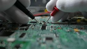 Electronic circuit board repair and testing stock video footage