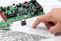 Electronic circuit boards. On the background of electronic scheme stock image