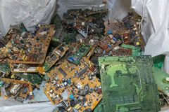Electronic circuit boards from used television sets waiting to be recycled on a recycling plant site. Sorted electronic garbage.  royalty free stock photography