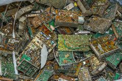 Electronic circuit boards from used television sets waiting to be recycled on a recycling plant site. Sorted electronic garbage.  stock image