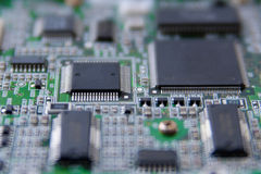 Electronic circuit microchip. Close-up microchips on green circuit board Stock Photography