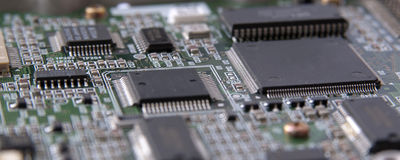 Electronic circuit microchip. Close-up microchips on green circuit board Royalty Free Stock Images