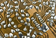 Electronic circuit plate. Old brown electronic circuit plate Royalty Free Stock Images
