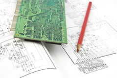 Electronic circuit plate,red pencil. And schematic diagram Stock Images
