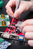 Electronic circuit red board inspecting close up Stock Photography