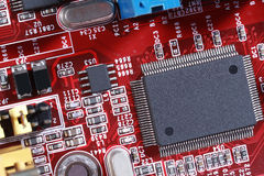 Electronic circuit red board with processor Royalty Free Stock Photography