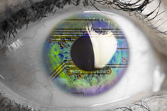 Electronic circuit reflected in a human eye Stock Photo