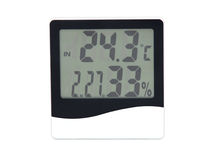 Electronic clock, calendar, thermometer and hygrometer Royalty Free Stock Photo