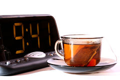 Electronic clock and tea Royalty Free Stock Photos