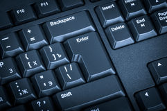 Electronic collection - black computer keyboard. The focus on th Royalty Free Stock Images