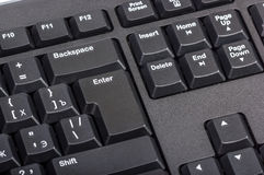 Electronic collection - black computer keyboard with key enter Royalty Free Stock Image